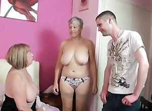 Two seducing matures lick and fuck a horny young dude