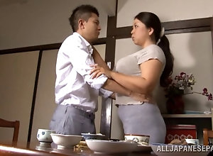 Chubby Japanese Milf with great tits rides her hubby's shaft