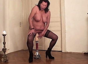 Stockinged Milf moans while trying to ride a huge dildo