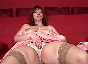 Big booty mature cutie Morgan toys her twat on sofa