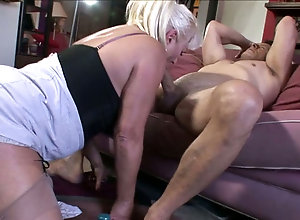 Kinky mature granny gives young muscular stud an unforgettable blowjob