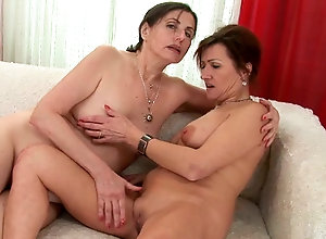 Two Average Looking Mature Ladies Engage In Steamy Lesbian Sex